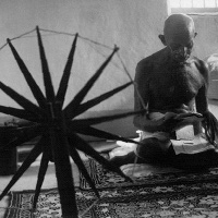 Gandhi at spinning wheel